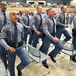Fourth squad leader Kearney Brown Jr., Left, and fellow Mississippi Highway Safety Patrol cadets make a grand entrance Thursday their commencement ceremony at the Clyde Muse Center in Pearl. Gov. Phil Bryant gave the commencement address to 48 members of Cadet Class 61.