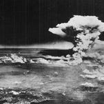 This Aug. 6, 1945, photo shows a mushroom cloud billowing into the sky about an hour after an atomic bomb was detonated above Hiroshima, Japan.