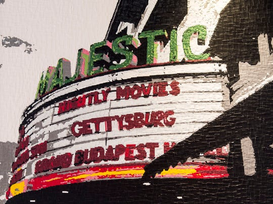 Gettysburg's Majestic Theater, one of Kerry Mott's duct tape finished art pieces, hangs in Knob Hall Winery in Gettysburg. Hundreds of hours and thousands of pieces of duct tape go into making such a piece.