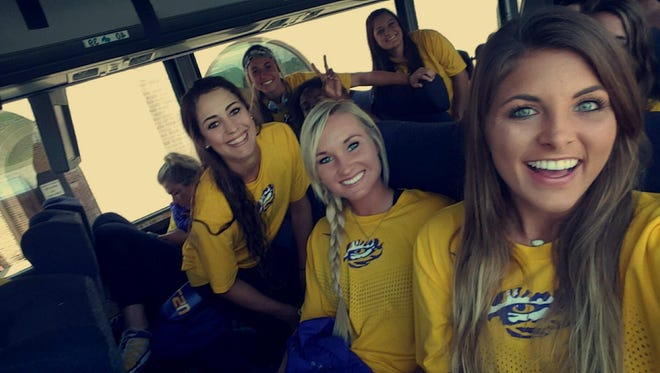 LSU senior Jenna Kreamer, center, who prepped at Evangel Christian Academy, is currently in Oklahoma City preparing for the Women's College World Series.