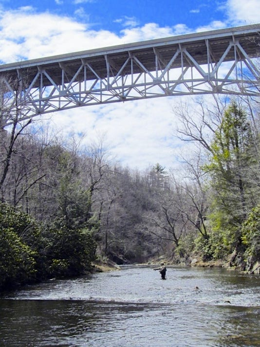 An angler fishes a stretch of Mud Run near a proposed natural gas pipeline crossing in Carbon County's Hickory Run State Park.