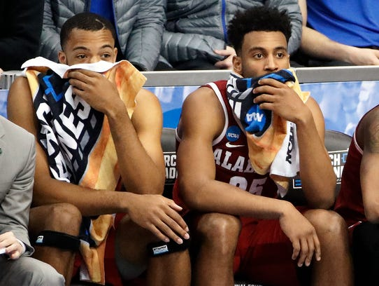 Alabama 's Braxton Key, right, sits with a teammate