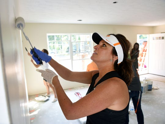 Led by Barb Jones (wife of Butch Jones), wives of coaches from the University of Tennessee football program painted the walls on a Habitat for Humanity home to be purchased by Whitnee Holloway Wednesday, Jul. 26, 2017.