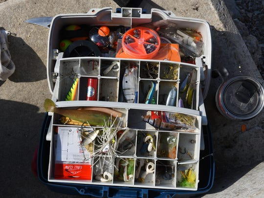 Tommy Bohannon's tackle box as he fishes below the Fort Loudoun Dam in Lenoir City Tuesday, June 19, 2018. Fort Loudoun is a popular recreation destination, known for bass fishing, boating and birdwatching. The tailwater area immediately below the dam is also a good site for viewing a variety of waterbirds, including osprey and bald eagles.