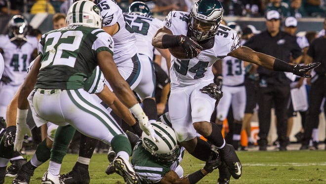 Eagles running back Henry Josey (No. 34) cuts past a defender in the first quarter of a preseason football game at Lincoln Financial Field on Thursday night, August 28, 2014.
