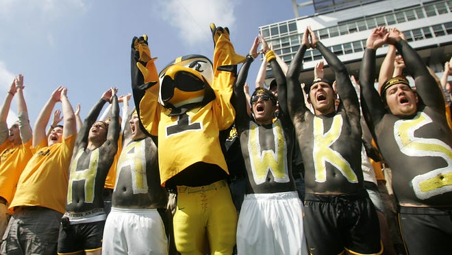 Herky joins fans in the student section.