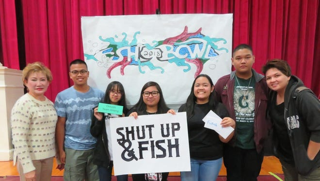 Second place winners of the 18th Annual FishBowl competition is Team Alileng from Okkodo High School. The team will be going fishing on the Don Pedro with Shut Up & Fish.  They also received tickets for a visit to FishEye Observatory.  Pictured from left: Geraldine Nucum, coach, Jesus Santos, Ashley Ignacio, Elvie Bravo, Judy Velasco, Mark Ganzon, Dominique La Coste, assistant coach on March 24.