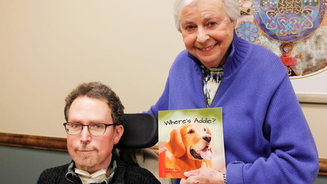 "Michael Luber (left) and his mother, Donna Luber, display their recently published book ""Where's Addie?"""
