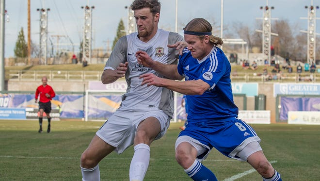Reno 1868 FC #8 Mackenzie Pridham and Sacramento Republic FC #33 fight for the ball in the first half of their match at Greater Nevada Field on Saturday, March 11, 2017.
