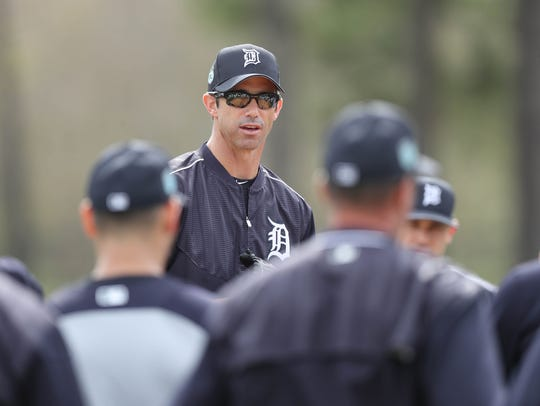 Tigers manager Brad Ausmus talks to his players during