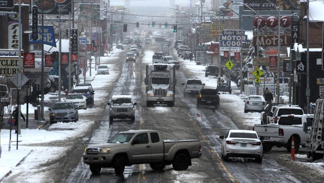 Messy road conditions are seen on Virginia St. in midtown Reno on Jan. 12, 2017.
