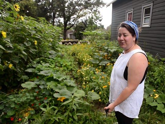 Ren Weiner of Winooski, owner of Miss Weinerz American Sweets, seen in her home garden.