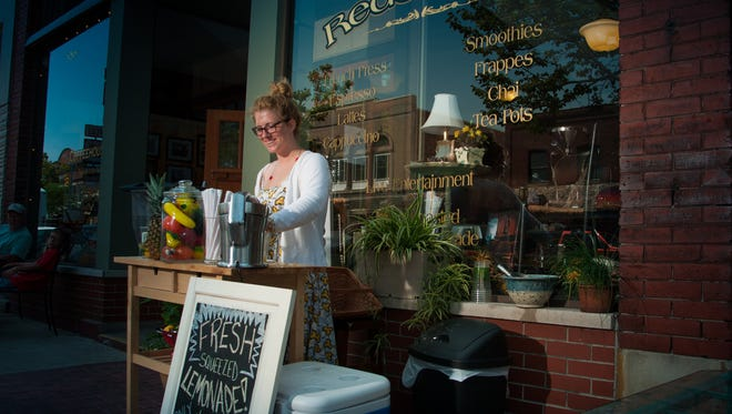 Downtown Ludington - a shop keeper outside of Redolencia, an independent coffee shop on Ludington Avenue downtown.