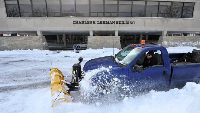Erick Rodenburgh, a building maintenance worker with York Suburban School District, clears out snow in front of the high school on Monday, Jan. 25, 2016. The school was closed both Monday and Tuesday due to this weekend's snowstorm.
