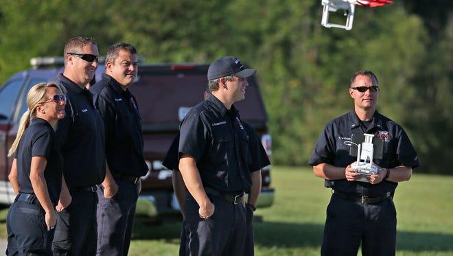 Wayne Township Fire Department fighters train on drones at the Wayne Township Fire Department Educational Complex, Thursday, September 10, 2015.