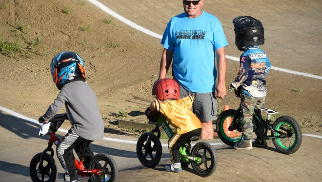 Mark Post gets the youngest riders started off during racing Thursday, July 28 at Pineview Park BMX in St. Cloud.
