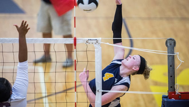 Delta's Chloe Stitt hits past Central's defense during their game at Delta High School Tuesday evening.