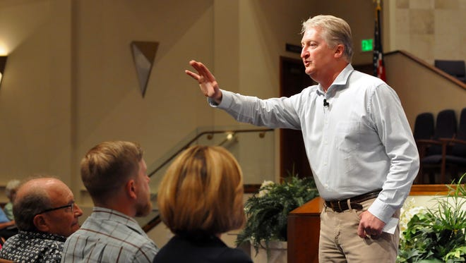 Andy Andrews moves closer to the audience during the season opener for the Bonita Christian Forum Nov. 14 at First Presbyterian Church of Bonita Springs.