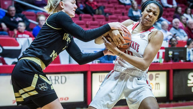 Ball State's Destiny Washington fights for possession against Western Michigan's defense at Worthen Arena Saturday, Jan. 7, 2017.