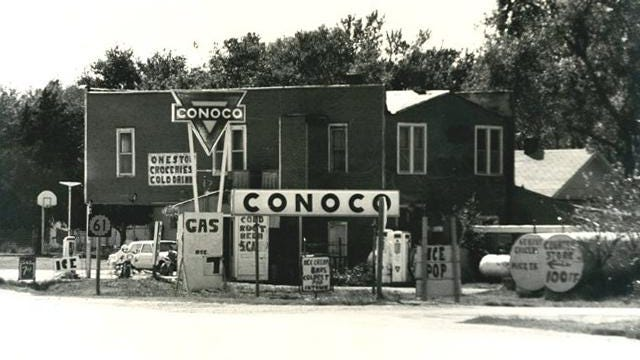 The Conoco service station and garage are seen in this 1961 photo with the business owned by Ted Smith.