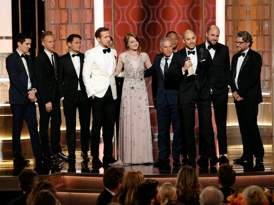 This image released by NBC shows the cast and crew