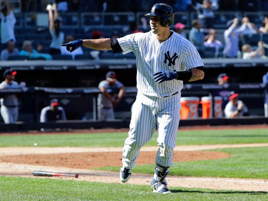 New York Yankees' Gary Sanchez celebrates after hitting the game winning three-run home run during the ninth inning of a baseball game against the Minnesota Twins Thursday, April 26, 2018, in New York. The Yankees won 4-3.