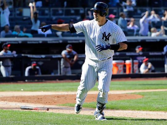 New York Yankees' Gary Sanchez celebrates after hitting