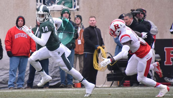 Tony Lippett (14) leaves Rutgers' Lorenzo Waters behind on his way to a first quarter touchdown as MSU hosts Rutgers, Saturday afternoon Nov. 22, 2014, at Spartan Stadium in East Lansing.