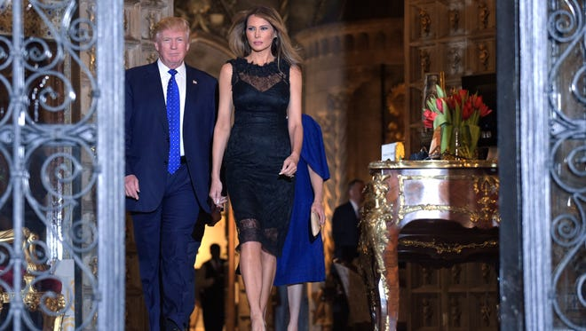 President Donald Trump and first lady Melania Trump at Mar-a-Lago in Palm Beach, Fla., on Saturday. Trump reportedly crashed the wedding of Carl Lindner IV while he was at his resort. (AP Photo/Susan Walsh)