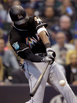 Marlins centerfielder Lewis Brinson cracks a three-run homer against the Brewers in the second inning, giving Miami a 4-0 lead at the time.