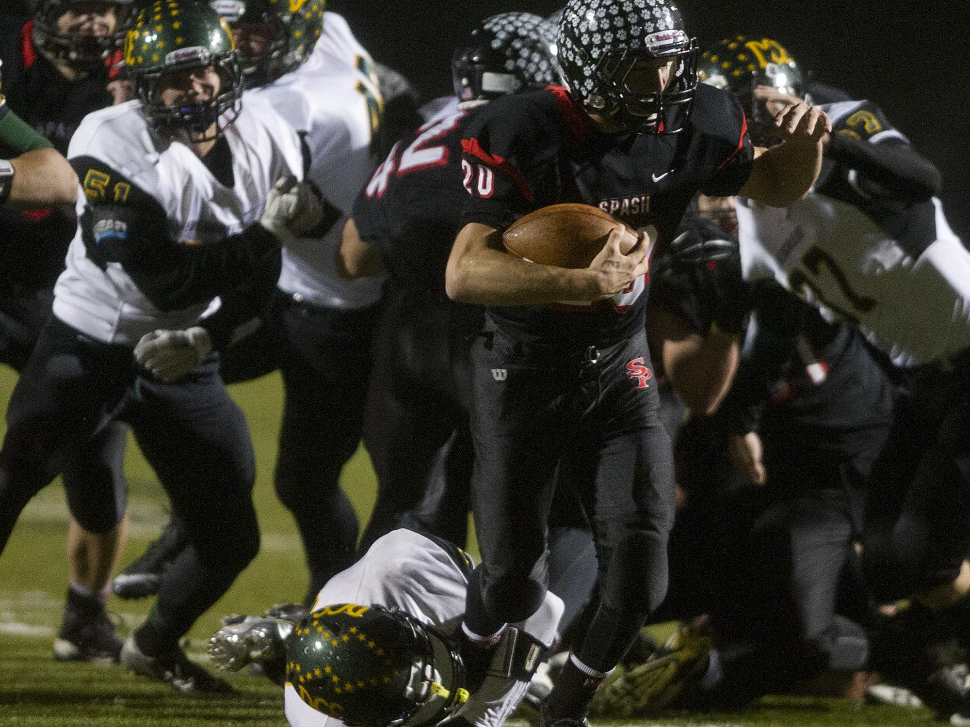 Stevens Point Area Senior High's Gus Turner-Zick carries the ball Friday during a WIAA Division 1 playoff game against D.C. Everest at Goerke Field in Stevens Point.