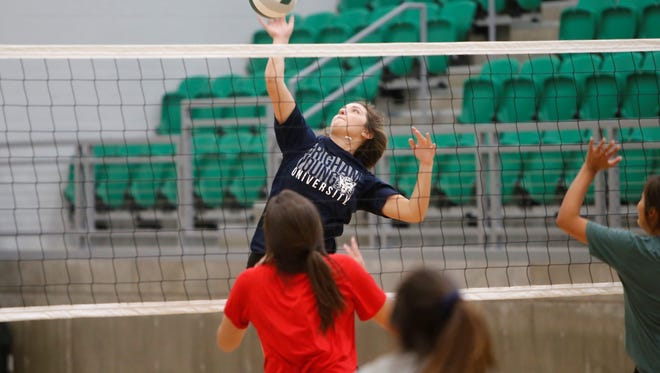 Bergen Campbell puts down a kill attempt during Farmington volleyball practice Thursday at Scorpion Arena. Campbell, Alyssa Simmons and JJ Curry are key returners on offense entering 2018.