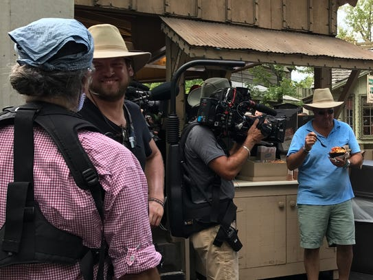 Andrew Zimmern gets ready to sample a treat during