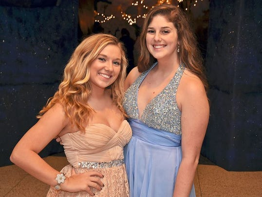 Students from South Western High School pose for a photo during their homecoming dance.