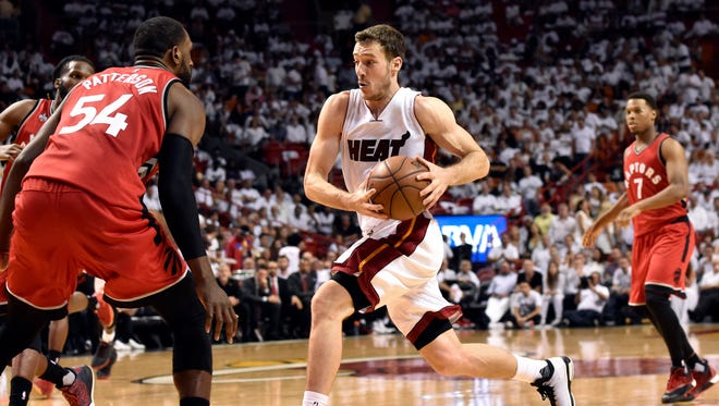 May 13, 2016; Miami, FL, USA; Miami Heat guard Goran Dragic (7) prepares to shoot the ball in front of Toronto Raptors forward Patrick Patterson (54) during the third quarter in game six of the second round of the NBA Playoffs at American Airlines Arena. Mandatory Credit: Steve Mitchell-USA TODAY Sports