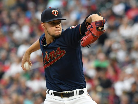 Minnesota Twins pitcher Jose Berrios throws to a Kansas City Royals batter during the first inning of a baseball game Saturday, Sept. 21, 2019, in Minneapolis. (AP Photo/Tom Olmscheid)