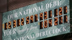 The National Debt Clock is shown Monday, Feb. 1, 2010 in New York. President Barack Obama sent Congress a $3.83 trillion budget on Monday that would pour more money into the fight against high unemployment, boost taxes on the wealthy and freeze spending for a wide swath of government programs. The deficit for this year would surge to a record-breaking $1.56 trillion. The Debt Clock is a privately funded estimate of the national debt. (AP Photo/Mark Lennihan) ORG XMIT: NYML102