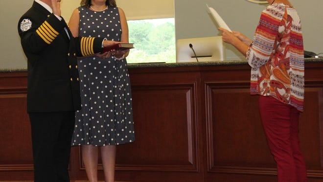 Chris Langlois being sworn in as the fire chief for the Town of Leland on Aug. 24.