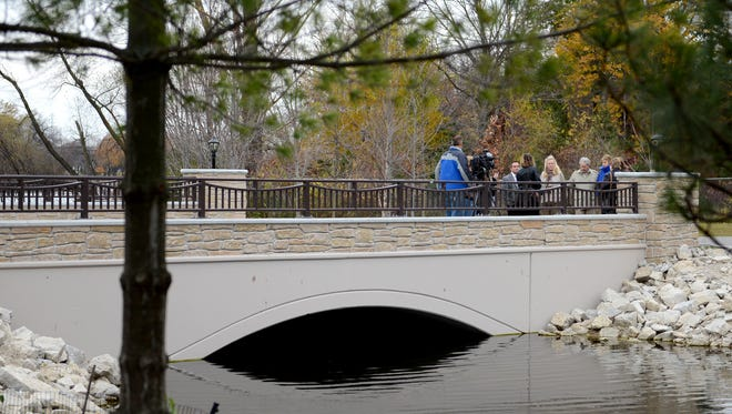 Officials dedicate the new Observation Building bridge during a ceremony Monday at the Bay Beach Wildlife Sanctuary in Green Bay.