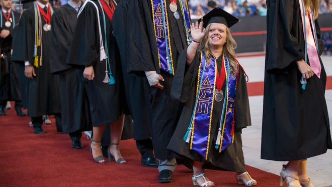 IUPUI graduates file into the main floor of Lucas Oil Stadium, Indianapolis, Sunday, May 14, 2017. This fourty-eighth commencement of Indianapolis University-Purdue University Indianapolis, saw graduates from 104 different countries.