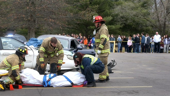 During a mock wreck Riverdale senior Tyler Redmon is placed in a body bag, in front of a group of Riverdale students on Tuesday, Feb. 14, 2017.