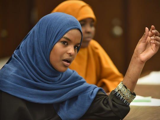 Najima Omar talks during a group meeting of Somali students May 28 at Tech High School.
