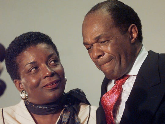 FILE - Cora Masters Barry, wife of Washington Mayor Marion Barry, looks on as the mayor grimaces during a news conference in this Thursday May 21, 1998 file photo. Barry, who staged a comeback after a 1990 crack cocaine arrest, died early Sunday morning Nov. 23, 2014. He was 78. Barry was married four times and is survived by his wife, Cora, and one son, Marion Christopher Barry. (AP Photo/Brian K. Diggs)