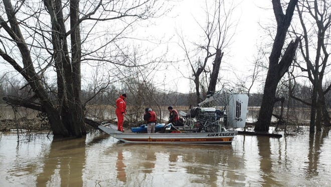 Indiana Department of Natural Resources officers search for missing kayaker Keygan Matlock along the Driftwood River near Columbus, Friday, April 6, 2018.