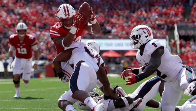 UW running back Jonathan Taylor gets stopped by Florida Atlantic's Hosea Barnwell in the second quarter on Sunday.