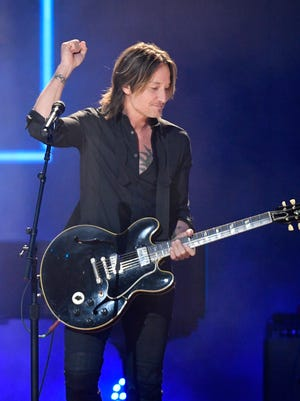 Keith Urban, one of the 2017 CMT Artists of the Year, performs during the show at the Schermerhorn Symphony Center on Oct. 18, 2017, in Nashville.