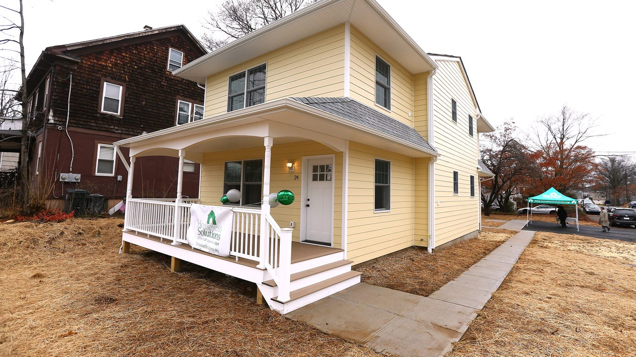 A disabled mother and her four children will finally have a permanent home at the newest dwelling opened in Morris Township by Homeless Solutions. IPHONE VIDEO BY WILLIAM WESTHOVEN FEB. 16, 2018