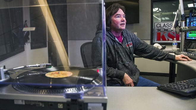 KSLX radio personality Russ Egan has been spinning vinyl records like this one by Gerry Rafferty and has gotten positive feedback from fans who love the nostalgia.