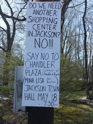 Jackson residents have posted protest signs concerning a proposed plaza