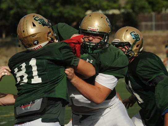 St. Bonaventure's Tyler Ostrom (center) is one of the